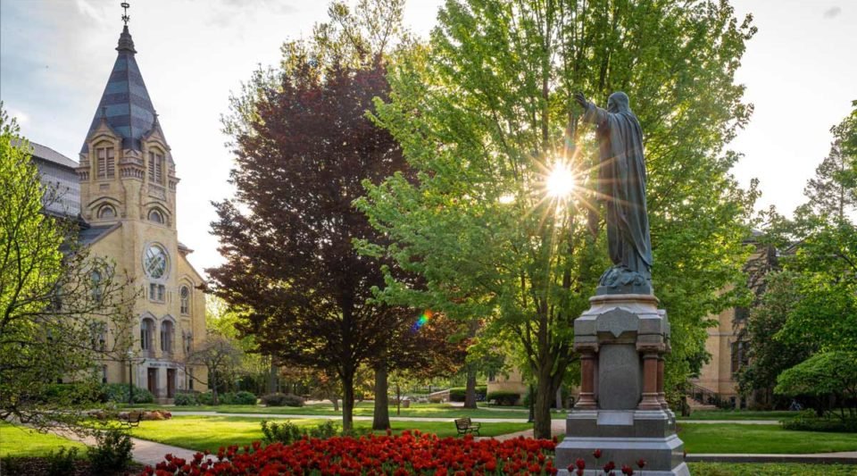 Sacred Heart Jesus statue and Washington Hall