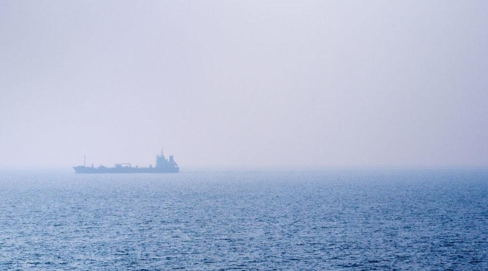 Ship on a foggy sea, early morning